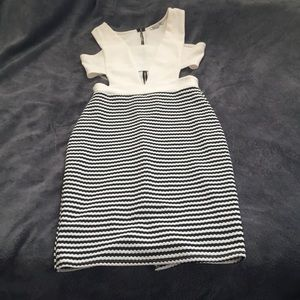 Selling a cream, and black knee length dress.